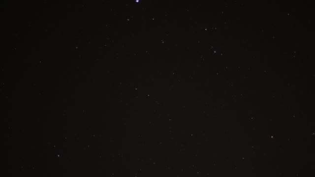 timelapse stars track through sky at night, oman - below stock videos and b-roll footage