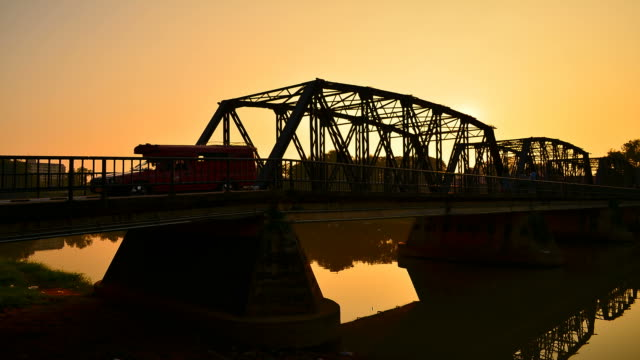 time-lapse: steel bridge at silhouette sunset - full hd format stock videos and b-roll footage