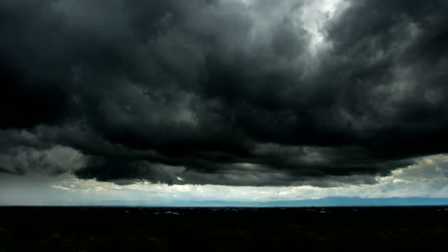 timelapse storm clouds with the rain - dramatic sky stock videos & royalty-free footage