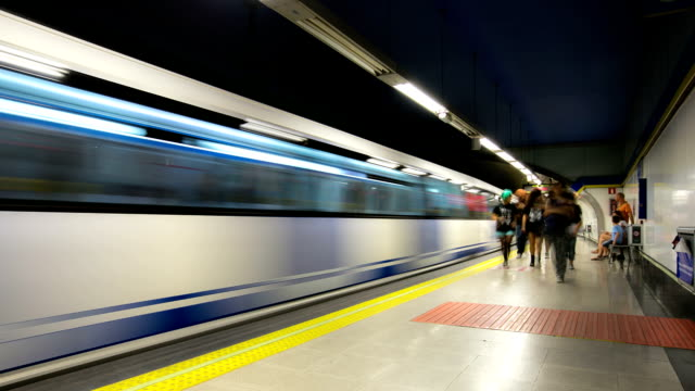 hd time-lapse: subway platform in madrid spain - underground rail stock videos & royalty-free footage