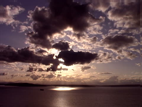 timelapse sun and clouds over puget sound - artbeats stock videos & royalty-free footage