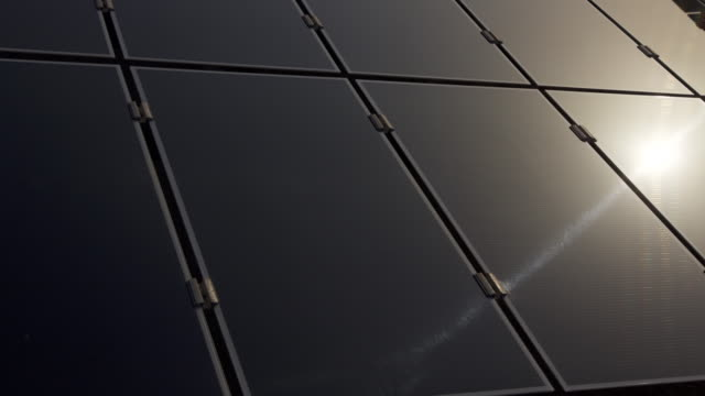 Timelapse sun reflected in solar panel at sunrise, Masdar, Abu Dhabi