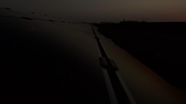 Timelapse sun reflected in solar panel at sunrise, Masdar, Abu Dhabi