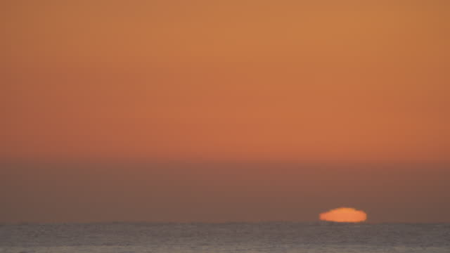Timelapse WS sun rising from horizon over open sea