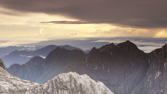 timelapse sun set over rocky peaks, mount kinabalu, borneo - mt kinabalu national park stock videos and b-roll footage