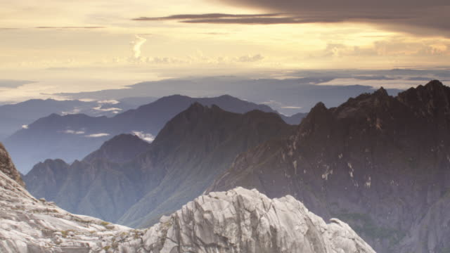 timelapse sun set over rocky peaks, mount kinabalu, borneo - sabah state stock videos and b-roll footage