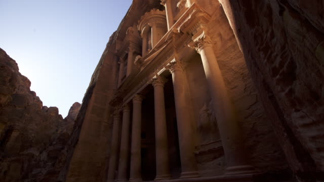 Timelapse sun tracks over ancient rock-cut treasury, Petra, Jordan