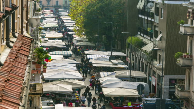 time-lapse: sunday market walking street in milan, italy, europe. - town square stock videos and b-roll footage