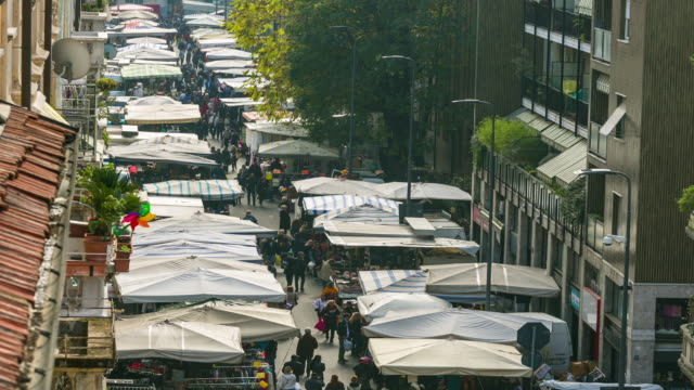 time-lapse: sunday market walking street in milan, italy, europe. - courtyard stock videos & royalty-free footage