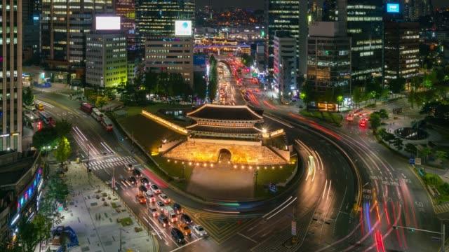 timelapse sungnyemun gate (namdaemun market) or namdaemun gate with light trails of car at night in seoul, south korea. - south korea stock videos & royalty-free footage