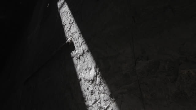 w/s timelapse sunlight advancing through a stone/cement wall - shade stock videos & royalty-free footage