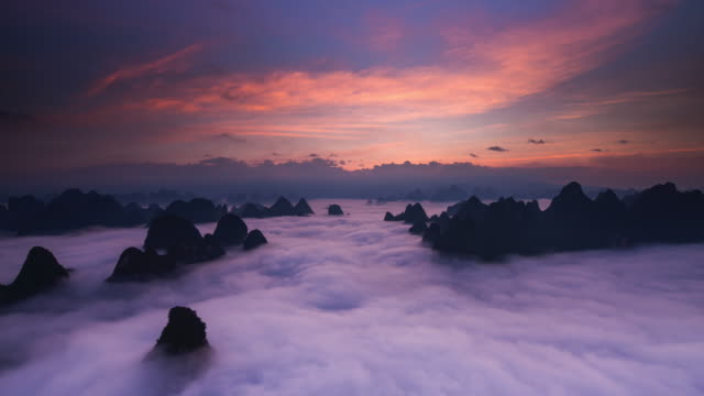 timelapse sunrise above clouds part 1 - tranquility stock videos & royalty-free footage