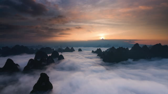 timelapse sunrise above clouds part 2 - digital composite stock videos & royalty-free footage