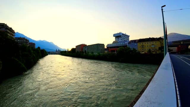 time-lapse: sunrise above the old town of innsbruck, austria - innsbruck stock videos and b-roll footage