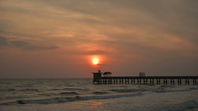 timelapse sunrise on the beach and sea - pier stock videos & royalty-free footage