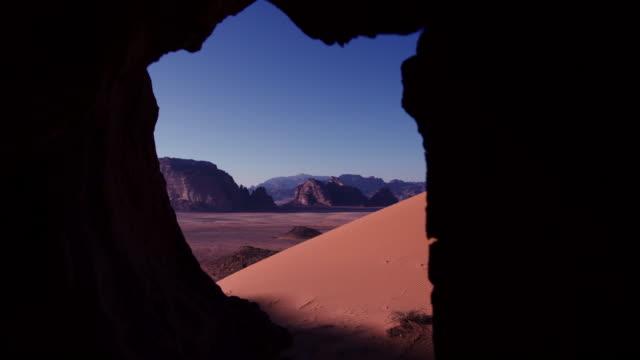 Timelapse sunrise over desert dune, Wadi Rum, Jordan