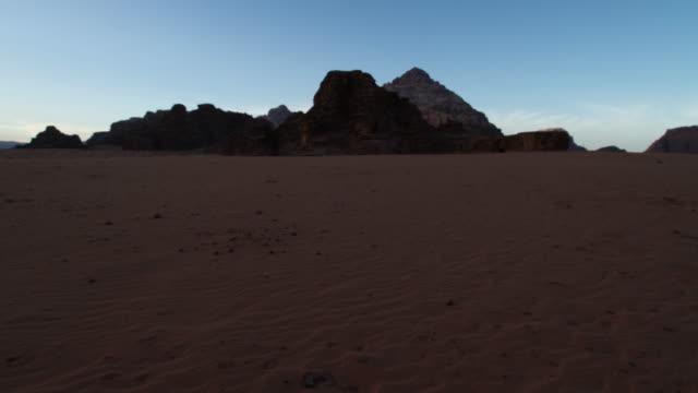 timelapse sunrise over desert valley, wadi rum, jordan - abandoned stock videos and b-roll footage