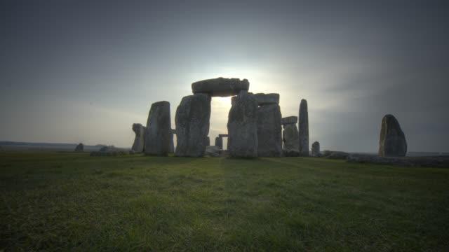 timelapse sunrise over prehistoric stonehenge monument, wiltshire, uk - obelisk stock videos & royalty-free footage
