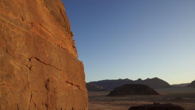 timelapse sunrise over rock and petroglyphs, wadi rum, jordan - prehistoric art stock videos & royalty-free footage