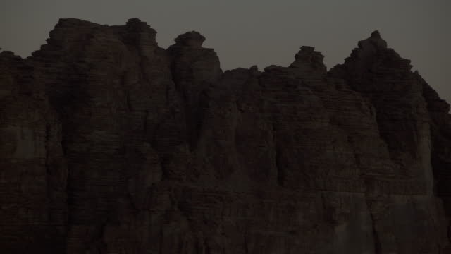 timelapse sunrise over sandstone mountains in desert, wadi rum, jordan  - sandstone stock videos & royalty-free footage