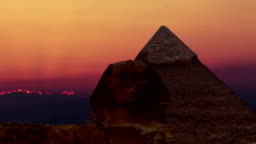 Timelapse. Sunrise over the pyramid of Cheops and Sphinx. Giza Egypt. v.1
