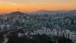 Time-lapse sunrise scene of Seoul downtown city skyline