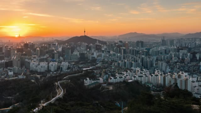 timelapse sunrise scene of seoul downtown city skyline - south korea stock videos and b-roll footage