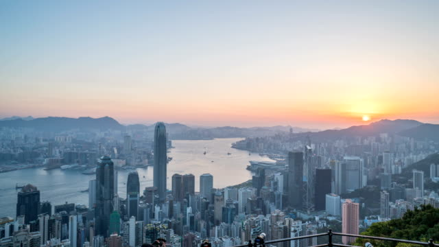 4k timelapse - sunrise shot of hong kong city pov from victoria peak - central plaza hong kong stock videos & royalty-free footage