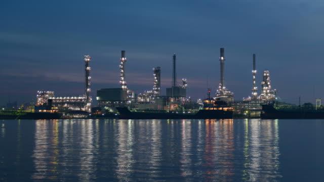 4K Time-lapse: Sunrise time lapse, petrochemical oil refinery plant.