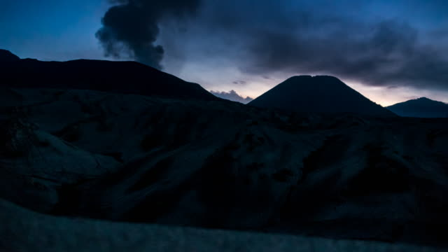 time-lapse sunset at mount bromo and batok - tengger stock videos & royalty-free footage