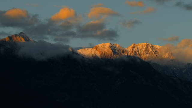 time-lapse: sunset at nordkette mountain range, innsbruck - innsbruck stock videos and b-roll footage
