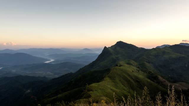 a time-lapse sunset at peak of mountains - chiang rai province stock videos and b-roll footage