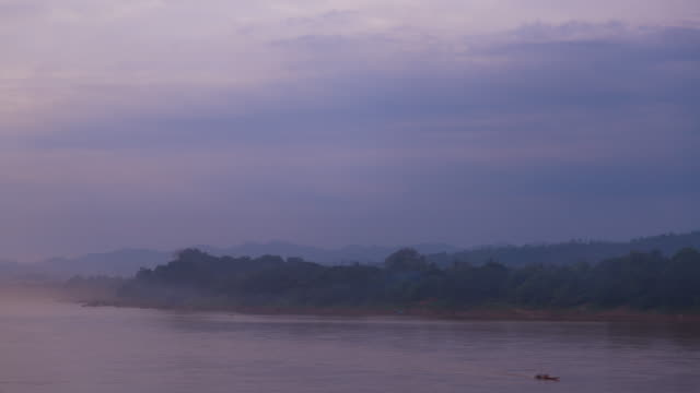 4K Timelapse: Sunset in Mekong River.