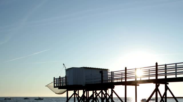 timelapse sunset ocean - hd - floating moored platform stock videos & royalty-free footage