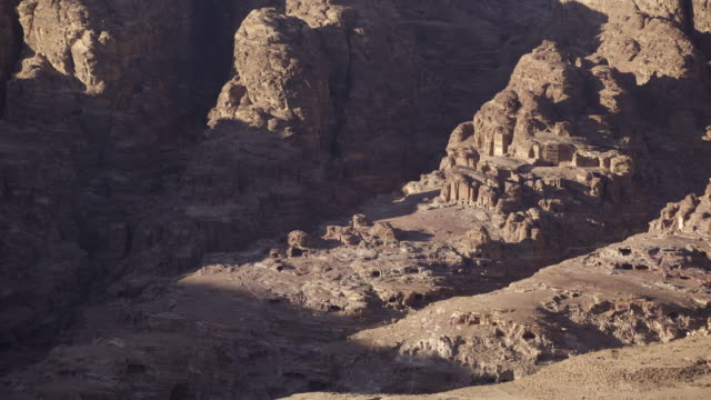 Timelapse sunset over desert mountains and ruins, Petra, Jordan