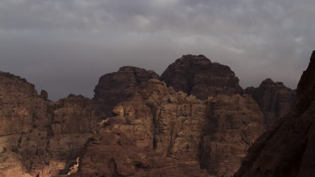 Timelapse sunset over desert mountains, Petra, Jordan
