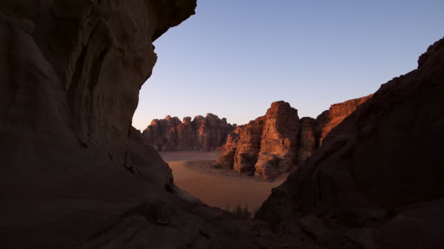 Timelapse sunset over desert valley, Wadi Rum, Jordan