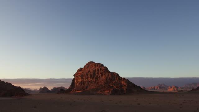Timelapse sunset over desert valley, Wadi Rum, Jordan
