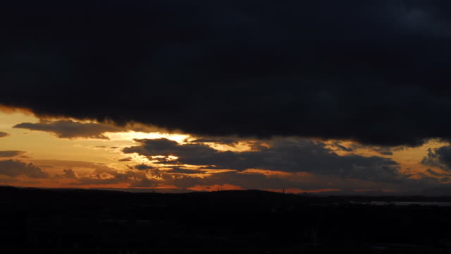 timelapse sunset over edinburgh - generic location stock videos & royalty-free footage