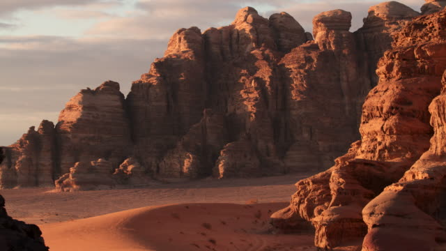 Timelapse sunset over sandstone mountains in desert, Wadi Rum, Jordan