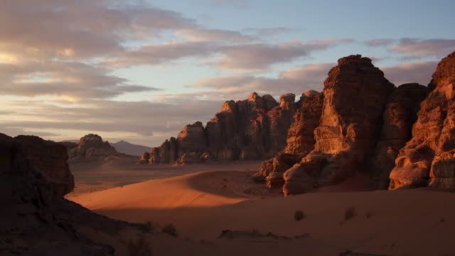 timelapse sunset over sandstone mountains in desert, wadi rum, jordan  - sandstone stock videos & royalty-free footage