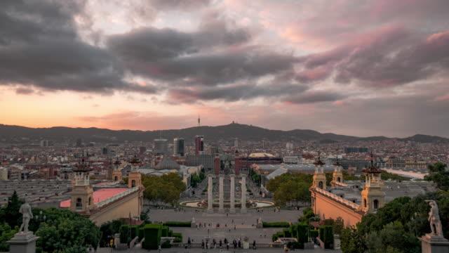Timelapse sunset over the Barcelona cityscape from Montjuic mountain, Spain