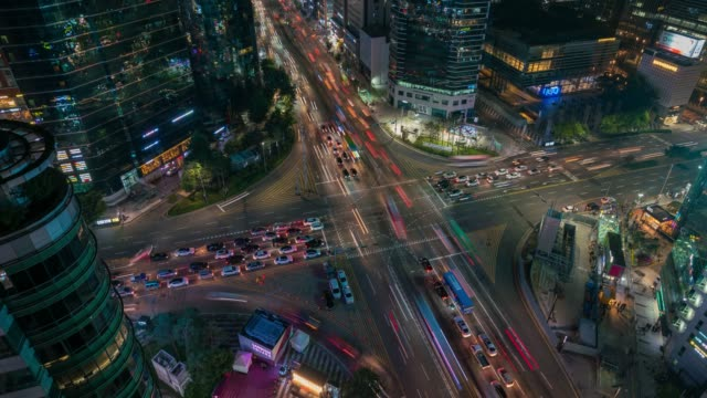 timelapse sunset scene of light trails traffic speeds through an intersection in gangnam center business district of seoul at seoul city, south korea. - protruding stock videos & royalty-free footage
