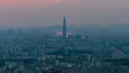 Time-lapse sunset scene over Seoul city view from Namhansanseong fortress. The best view of skyscrapers lit up with the han river in the background at Seoul city, South Korea