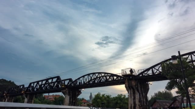 time-lapse: sunset the bridge river kwai - bridge built structure stock videos and b-roll footage