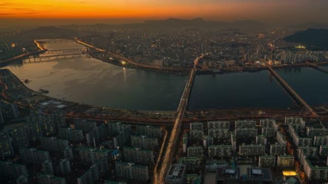 Timelapse sunset view of bridge cross over Han river at Seoul city in South Korea
