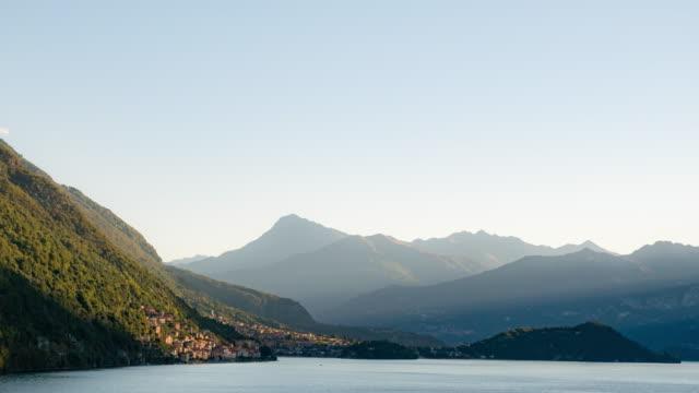 Timelapse sunshine over village,como lake italy