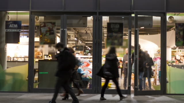 timelapse supermarket/shop entrance people going in and out - store stock videos & royalty-free footage