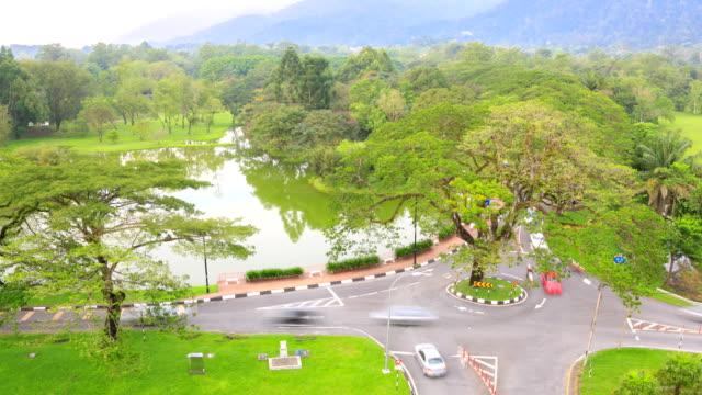 time-lapse: taiping lake garden perak malaysia - traffic circle stock videos & royalty-free footage