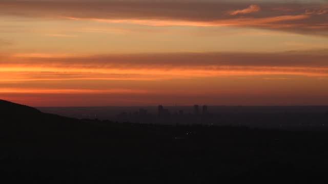time-lapse taken from red rocks amphitheater at sunrise of the denver skyline, on june 13, 2019. - red rocks stock videos & royalty-free footage
